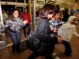 Shoppers rush into an Oakland, Calif., Wal-Mart as the store opens its doors at 5 a.m. on Friday, Nov. 28, 2008. Several hundred people lined up over night awaiting Black Friday deals. (AP Photo/Noah Berger)