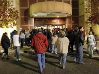 Early morning shoppers enter J.C. Penney at Penn Square Mall in northwest Oklahoma City at 3:45 a.m., local time  on Black Friday, Nov 28, 2008. (AP Photo/The Oklahoman, David McDaniel)