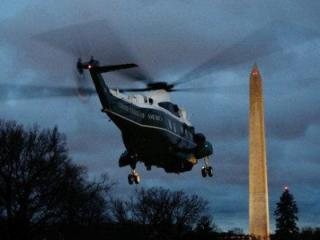 In the 2008 file photo, President George W. Bush leaves in the early morning aboard Marine One from the White House for a trip to Andrews Air Force Base, Md., and then onto Texas.