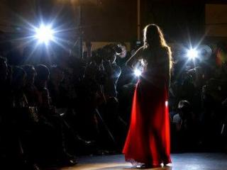 THURSDAY: A model presents a piece during Lebanon-based designer Gianni al Maanaki's show during Vancouver Fashion Week in Vancouver, B.C. (AP Photo/The Canadian Press, Darryl Dyck)
