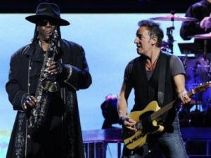 WEDNESDAY: Bruce Springsteen, right, performs alongside Clarence Clemons of the E Street Band during their concert in Los Angeles. (AP Photo/Chris Pizzello)