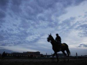 WEDNESDAY: Exercise rider Elias Lopez takes Kentucky Derby hopeful Win Willy for a workout for the 135th Kentucky Derby at Churchill Downs, in Louisville, Ky. (AP Photo/Morry Gash)