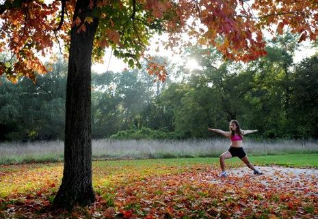 Natasha Pierce-Slive, 24, of Boston, Mass., practices yoga Tuesday afternoon, Sept. 22, 2009, under a maple tree in Lincoln Park in Racine, Wis. She and boyfriend, Paul Bartlett, were visiting his parents before going to Hawaii for a yoga retreat. (AP Photo/Journal Times, Gregory Shaver)