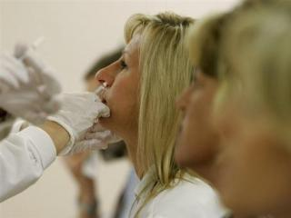 Infectious diseases clinical pharmacist Sharon Erdman becomes one of the first health care workers in the U.S. to get the H1N1 vaccine In the Occupational Health Clinic at Wishard Memorial Hospital in Indianapolis Oct. 5, 2009. (AP Photo/Darron Cummings)
