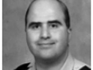 This undated image taken from the Uniformed Services University of the Health Sciences Fall 2007 newsletter shows Nidal Malik Hasan. Maj. Hasan an Army psychiatrist set to be shipped overseas opened fire Thursday Nov. 5, 2009 at the Fort Hood Army post, authorities said, a rampage that killed at least 13 people and left nearly 30 wounded in the worst mass shooting ever at a military base in the United States.(AP Photo/ Uniformed Services University of the Health Sciences )