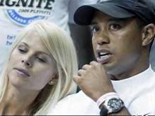 Woods, wife postpone questioning