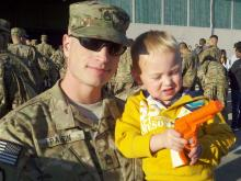 Sgt. 1st Class Eric Pahon of the 82nd Combat Aviation Brigade spends time with son Aiden on Oct. 1, 2011, before deploying to Afghanistan.