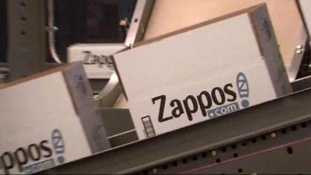 Zappos shoe boxes line up on a conveyor belt to be shipped. The online shoe seller is asking 24 million customers to change their passwords after hackers gained access to the company's internal server.