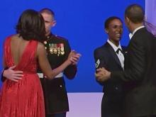 Obamas dance with service members