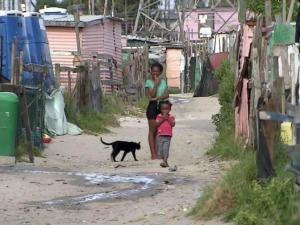 In the shadows of the Cape Town skyline, more than 2 million people live in a shantytown on the outskirts of South Africa's most cosmopolitan city.