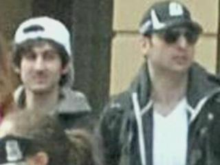 Security image of Dzhokhar Tsarnaev, wearing a white hat, and his brother, Tamerlan Tsarnaev, wearing a black hat, at the Boston Marathon on April 15, 2013, shortly before two bombs exploded, killing three people and injuring hundreds others.