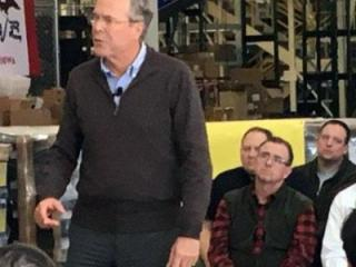 Republican presidential candidate Jeb Bush speaks at a gun manufacturing warehouse in Grinnell, Iowa, on Jan. 12, 2016.