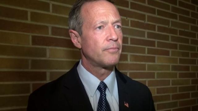 Democratic presidential candidate Martin O'Malley speaks with a student journalist from Elon University during a campaign stop in Ankeny, Iowa, on Jan. 13, 2016.