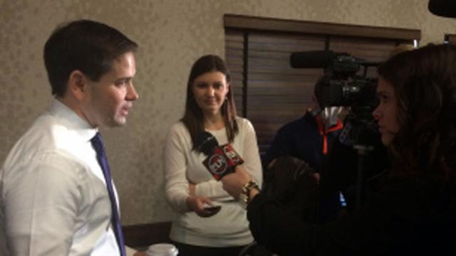 Republican presidential candidate Marco Rubio speaks with student journalists from Elon University in Des Moines, Iowa, on Jan. 17, 2016.