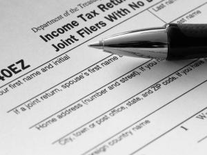 Tax season can be one of the most, well, taxing times of year, especially for chronic procrastinators who make up about 20 percent of the American public, according to research conducted at DePaul University. (c) Mariusz Blach - Fotolia.com
