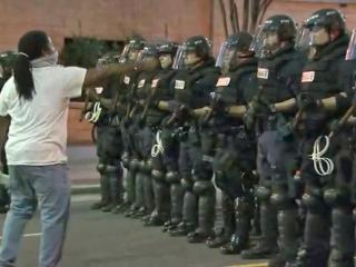 A protester confronted a line of officers in riot gear during a protest Wednesday night.
