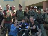 Paralyzed boy gets to be police officer for a day