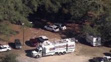 Police: Officer shot in Orlando, suspect still at large