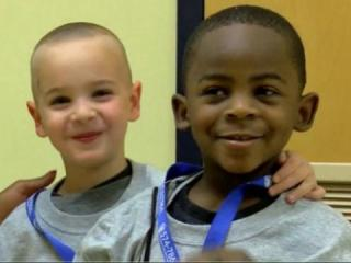 Two preschoolers- one black and one white- who gained national attention when they wanted to get the same haircut so their teacher wouldn't be able to tell them apart were recognized Monday for being role models.