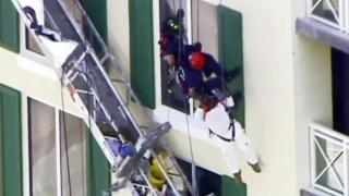 RAW: Dangling worker thanks rescuers