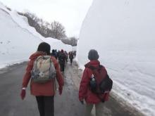 Road flanked by 26-foot-tall snow walls