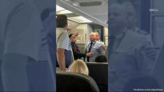 American Airlines apologizes after video shows mom in tears