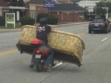 Lexington, NC man hauls furniture on scooter