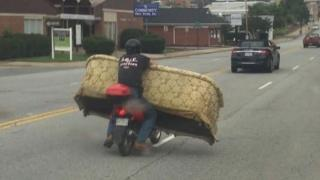 Lexington, NC man hauls furniture on scooter