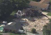 IMAGE: Sinkhole swallows homes in Florida