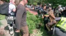 Rally organizer attempts to speak before getting punched, tackled