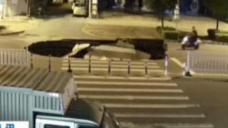 RAW: Motorcyclist drives into sinkhole as it forms