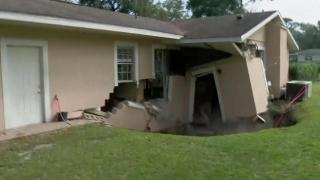 The moment part of a house collapses into sinkhole