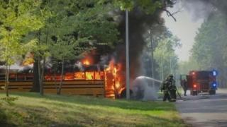 Driver pulls kids from burning school bus