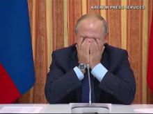 Putin cracks up at minister's comment about Muslims