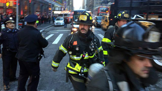 Police and firefighters on Eighth Avenue in New York following an explosion on Monday morning, Dec. 11, 2017. The explosion caused the authorities to evacuate one of the busiest transit hubs in the city as the workweek was set to begin. (David Scull/The New York Times)