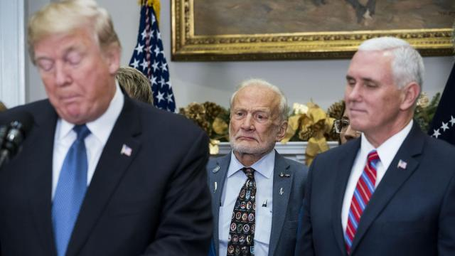 Astronaut Buzz Aldrin, center, and Vice President Mike Pence, right, look on as President Donald Trump speaks during a ceremony at which he signed Space Policy Directive 1 in the Roosevelt Room of the White House in Washington, Dec. 11, 2017. (Doug Mills/The New York Times)