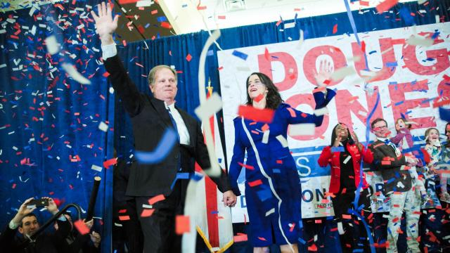 Doug Jones, the Democratic candidate for U.S. Senate, is accompanied by his wife, Louise, at an Election Night gathering of his supporters in Birmingham, Ala., on Dec. 12, 2017.  (Bob Miller/The New York Times)
