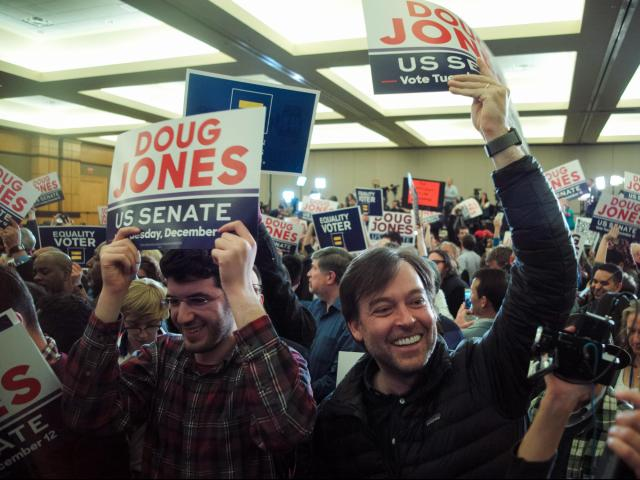 Supporters of Doug Jones, the Democratic candidate for U.S. Senate, celebrate at an Election Night gathering in Birmingham, Ala., on Dec. 12, 2017. Jones, a former prosecutor who mounted a seemingly quixotic campaign in the face of Republican dominance here, defeated his scandal-scarred opponent, Roy Moore, after a brutal campaign marked by accusations of sexual abuse and child molestation against the Republican. (Bob Miller/The New York Times)