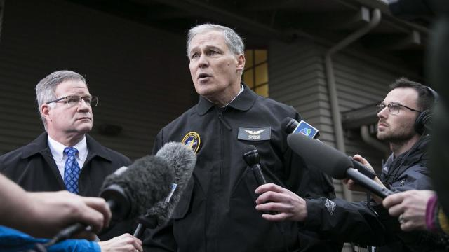 Jay Inslee, governor of Washington state, speaks to reporters at Dupont City Hall in Dupont, Wash., Dec. 18, 2017. Multiple people were killed and more than 75 were taken to local hospitals after an Amtrak train derailed from a highway overpass on Monday morning, according to local authorities. (Ruth Fremson/The New York Times)