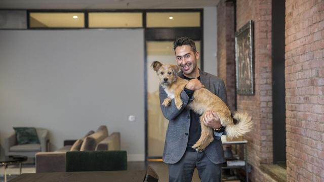 J.J. Hill at home with Taylor, the Yulin rescue dog his real estate broker gave him as a closing gift, in the TriBeCa neighborhood of New York, Dec. 12, 2017. Most brokers see closing gifts as part of the cost of doing business — a gesture to thank clients, and little more. Some go the extra mile. (Tony Cenicola/The New York Times)