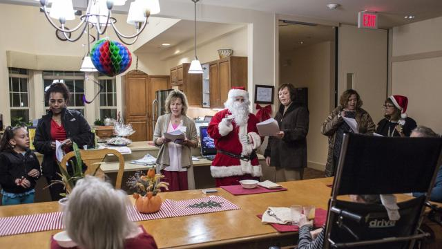 Staff, friends and family sing holiday carols to residents at a Green House at the Green Hill continuing care facility in West Orange, N.J., Dec. 18, 2017. At Green Houses, residents have more independence and facilities are less institutional — a big improvement over most nursing homes, new research finds. (Bryan Anselm/The New York Times)