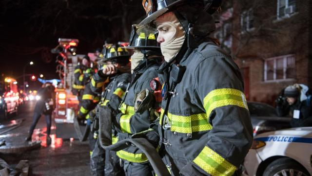 Firefighters at the scene of a deadly fire on Thursday night, Dec. 29, 2017, at a five-story apartment building in the Belmont section of the Bronx. Officials said at least 12 people were killed when a blaze fueled by gusty winds tore through the century-old apartment building, the deadliest fire in the city in more than a quarter-century. (David Dee Delgado/The New York Times)