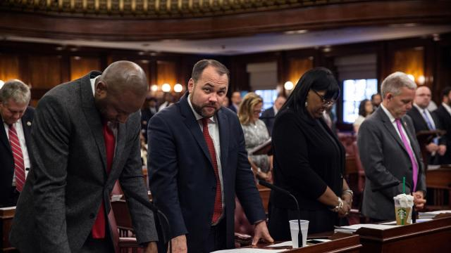 FILE — From left, New York City Councilmen Donovan Richards, Corey Johnson, Deborah Rose, and Jimmy Van Bramer during a prayer before the beginning of a city council meeting at City Hall, Sept. 27, 2017. New Yorkers may have overlooked local outrages in the fury to keep up with all of the extraordinary news in 2017. The race for City Council speaker, which resulted in the expected victory of Johnson, was a reminder that there are not many black politicians moving into more prominent leadership roles. (Holly Pickett/The New York Times)