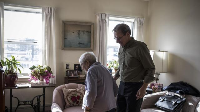 Ruth Willig, 94, during a physical therapy session with John Dlug, right, at a senior building in Sheepshead Bay, New York, Dec. 13, 2017. Gerontologists describe the paradox of old age: that as people's minds and bodies decline, instead of feeling worse about their lives, they feel better. Willig is very concerned about being independent, and she is passionate about her flowers. (Edu Bayer/The New York Times)