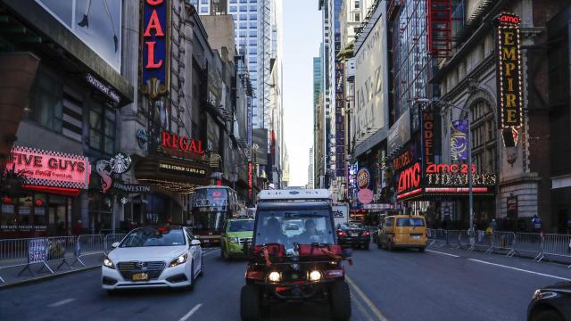 Emergency medical workers drive a Gator utility vehicle through Times Square in New York, Dec. 13, 2017. A unit of the New York Fire Department use the small two-passenger vehicles to respond to emergencies ahead of ambulances in congested Midtown Manhattan. (Jeenah Moon/The New York Times)