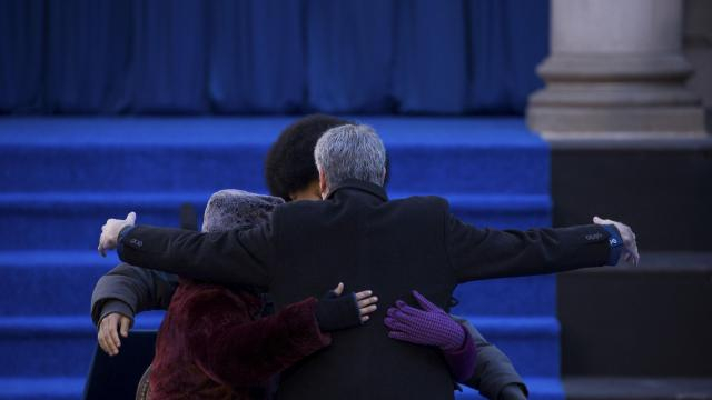 Mayor Bill de Blasio hugs his family after he was sworn in for his second term at City Hall Plaza in New York, Jan. 1, 2018. (Damon Winter/The New York Times)