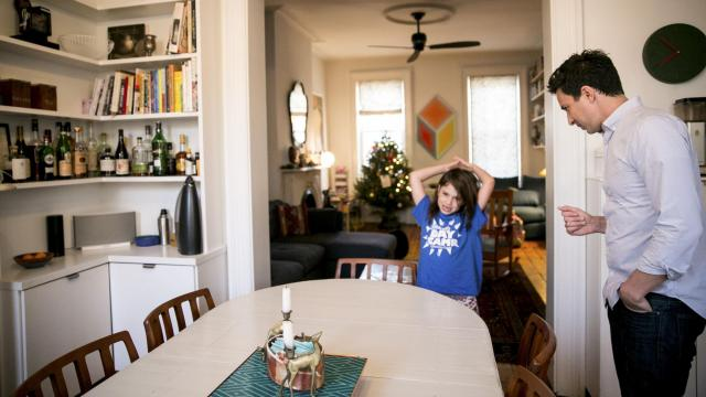 Sam Dolnick, who oversees digital initiatives at The New York Times, with his daughter, Stella, uses Alexa, Amazon's artificially intelligent assistant, through an Echo device at his home in New York, Jan. 3, 2018. Dolnick plays music on Alexa for his daughter most mornings. (Sam Hodgson/The New York Times)