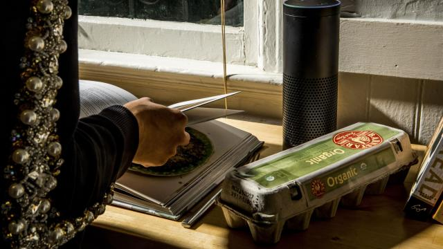 FILE-- An Amazon Echo speaker, which allows access to Alexa, Amazon's artificially intelligent assistant, in a home kitchen in San Francisco, Nov. 13, 2017. The stars of the 2018 International Consumer Electronics Show won't be flashy gadgets. Instead, the focus will be on artificial intelligence and its impact on homes, cities and cars. (Christie Hemm Klok/The New York Times)