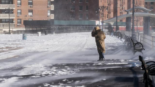 A pedestrian in the cold on the boardwalk in the Brighton Beach neighborhood of Brooklyn, Jan. 5, 2018. In the bone-chilling wake of a wind-propelled storm that left 7 to 10 inches of snow on the ground, the New York City Housing Authority was coping with temporary heating failures in dozens of buildings. (Todd Heisler/The New York Times).........(Todd Heisler/The New York Times)