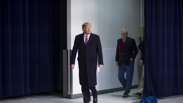 """President Donald Trump arrives for a news conference at Camp David in Maryland, Jan. 6, 2018. Flanked by congressional Republicans and members of his Cabinet Trump again insisted here that he was not under investigation by the special counsel investigating Russian influence on the 2016 election. """"Everything I've done is 100 percent proper,"""" Trump said. (Eric Thayer/The New York Times)"""